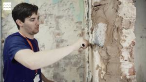 An Apprentice repairing wall